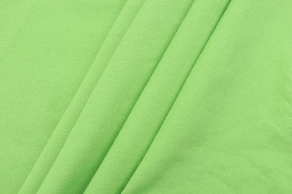 green textile on white textile