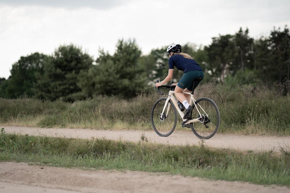man in black t-shirt riding on bicycle during daytime