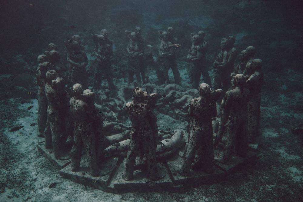 group of men standing on black metal frame