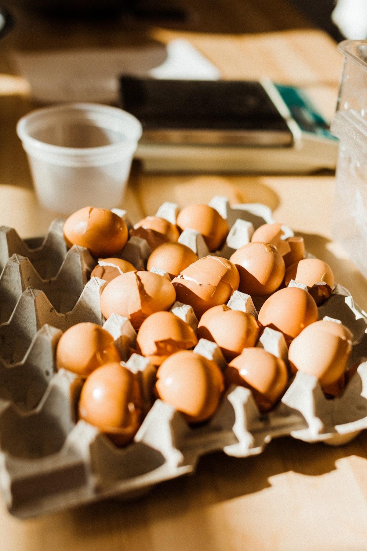 white and brown egg on white ceramic bowl