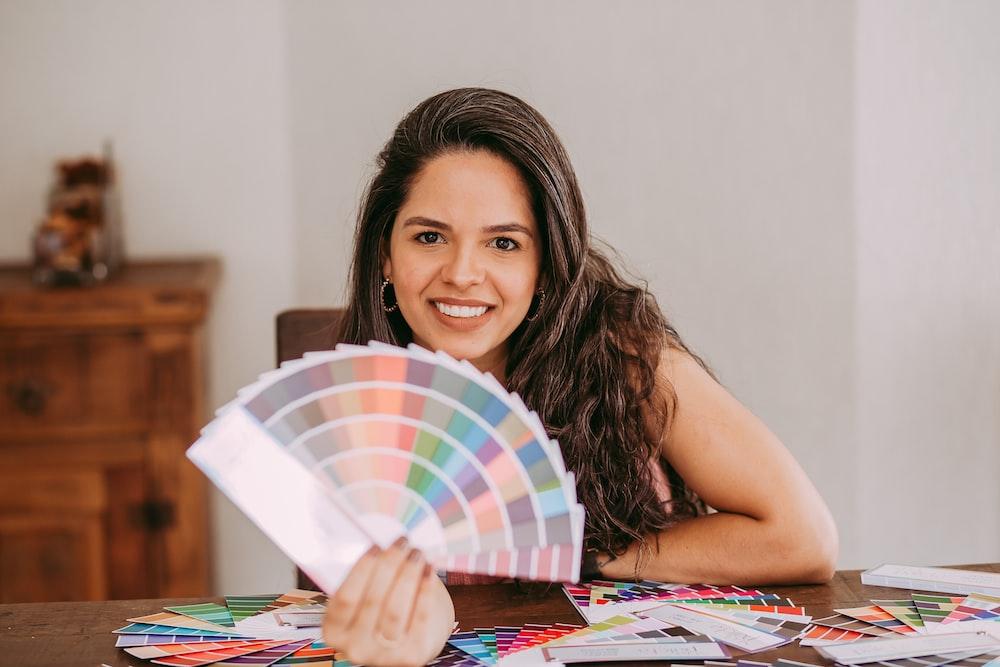 girl holding multi colored umbrella