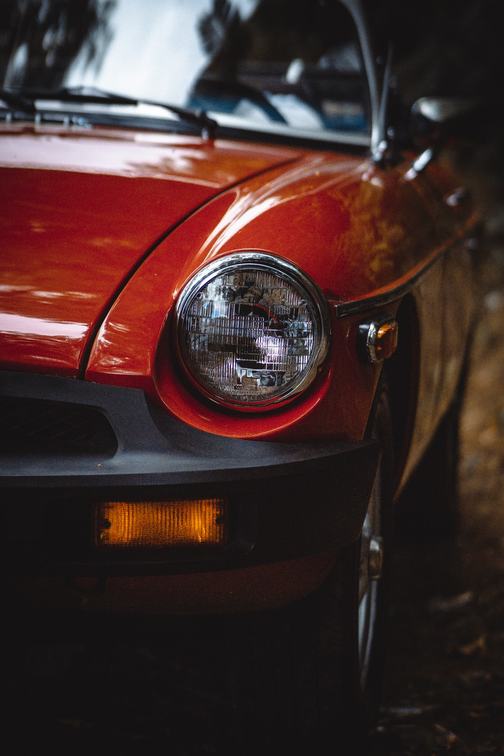 red car with black and silver headlight