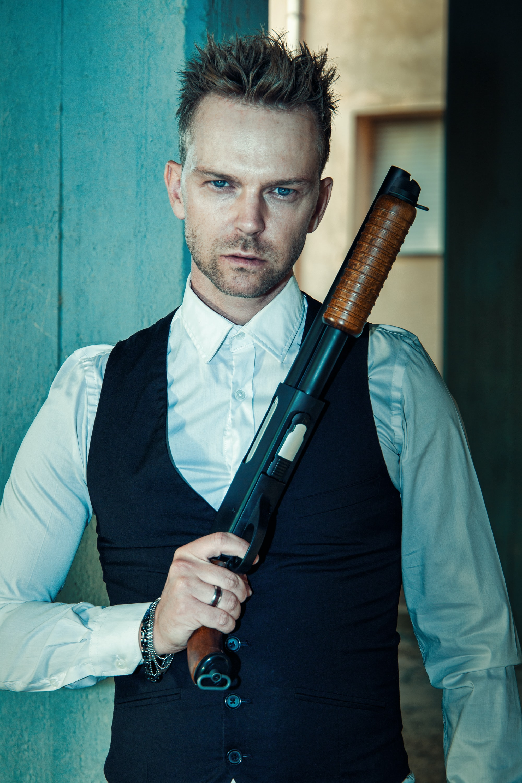 Mysterious man holding a shotgun
