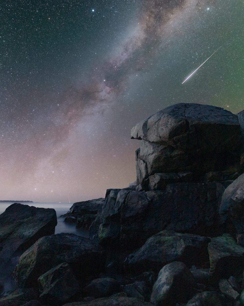 rocky mountain under starry night