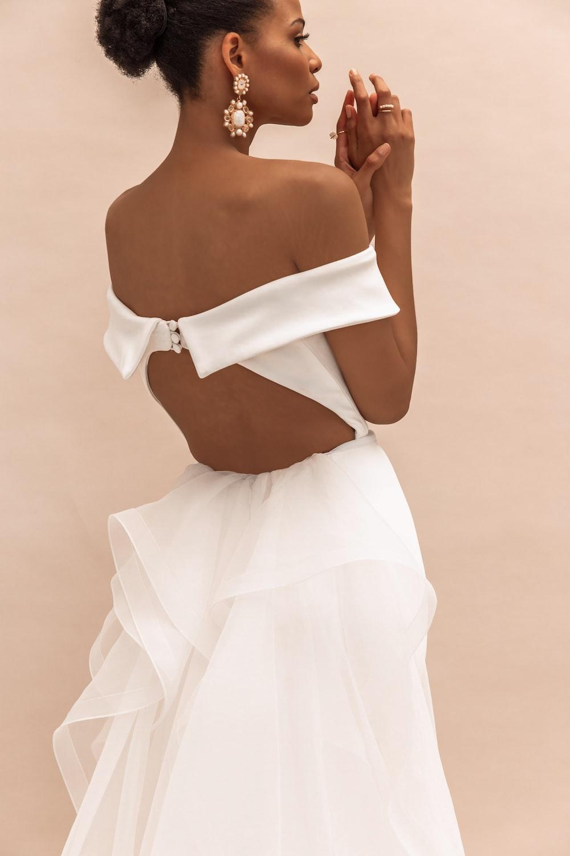woman in white tube dress