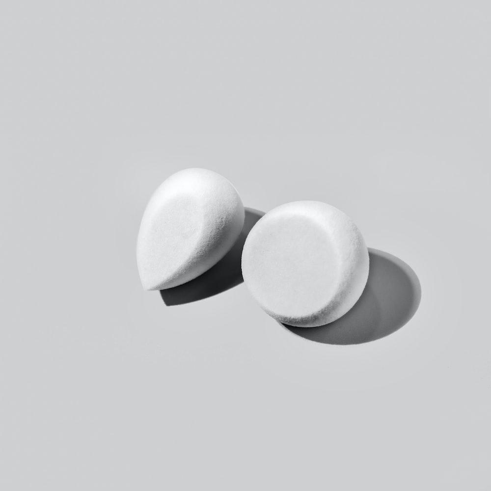 2 white eggs on white surface