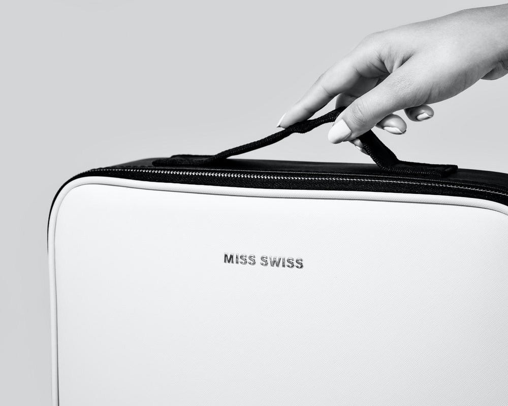 person holding white and black samsung laptop