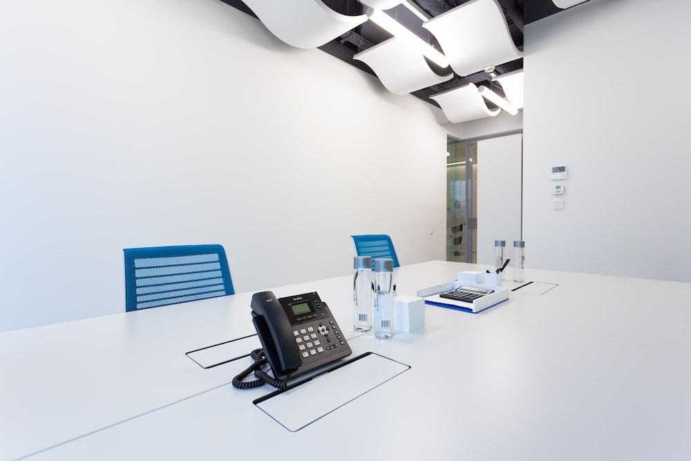 black ip desk phone on white table