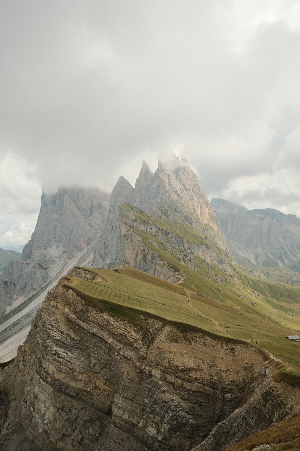 green and brown mountains under white cloudy sky during daytime