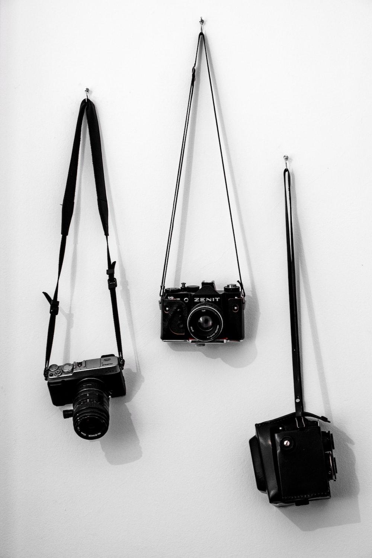 black dslr camera on white wall