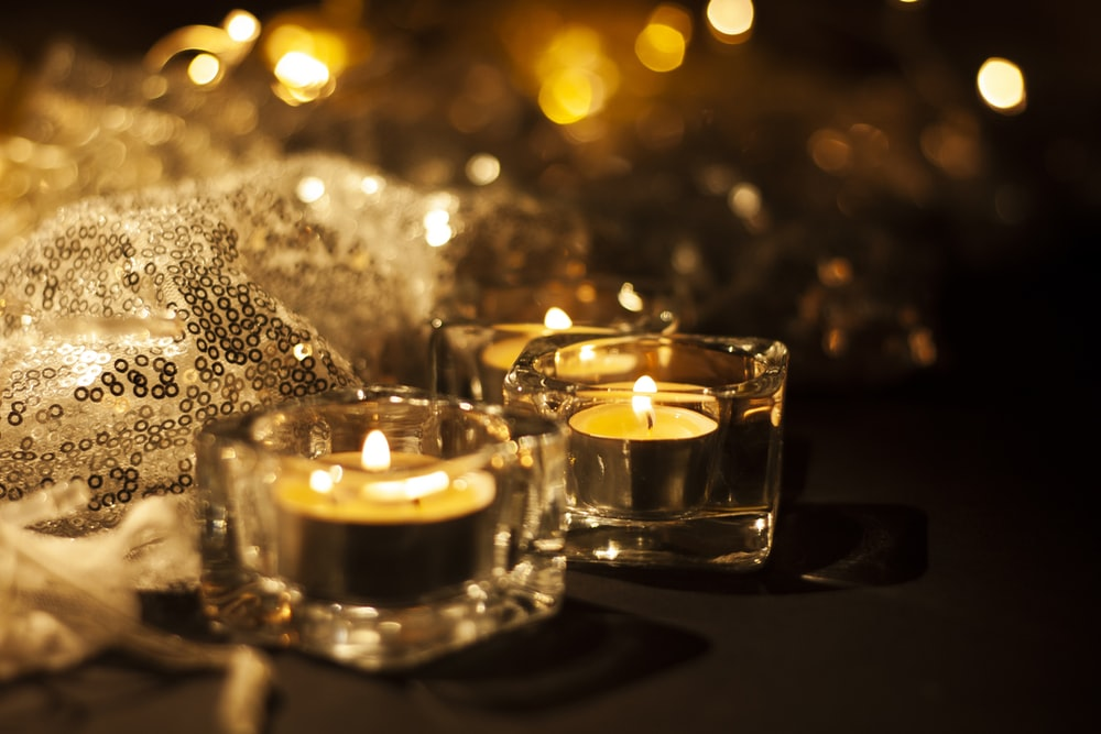 clear glass candle holder with candles
