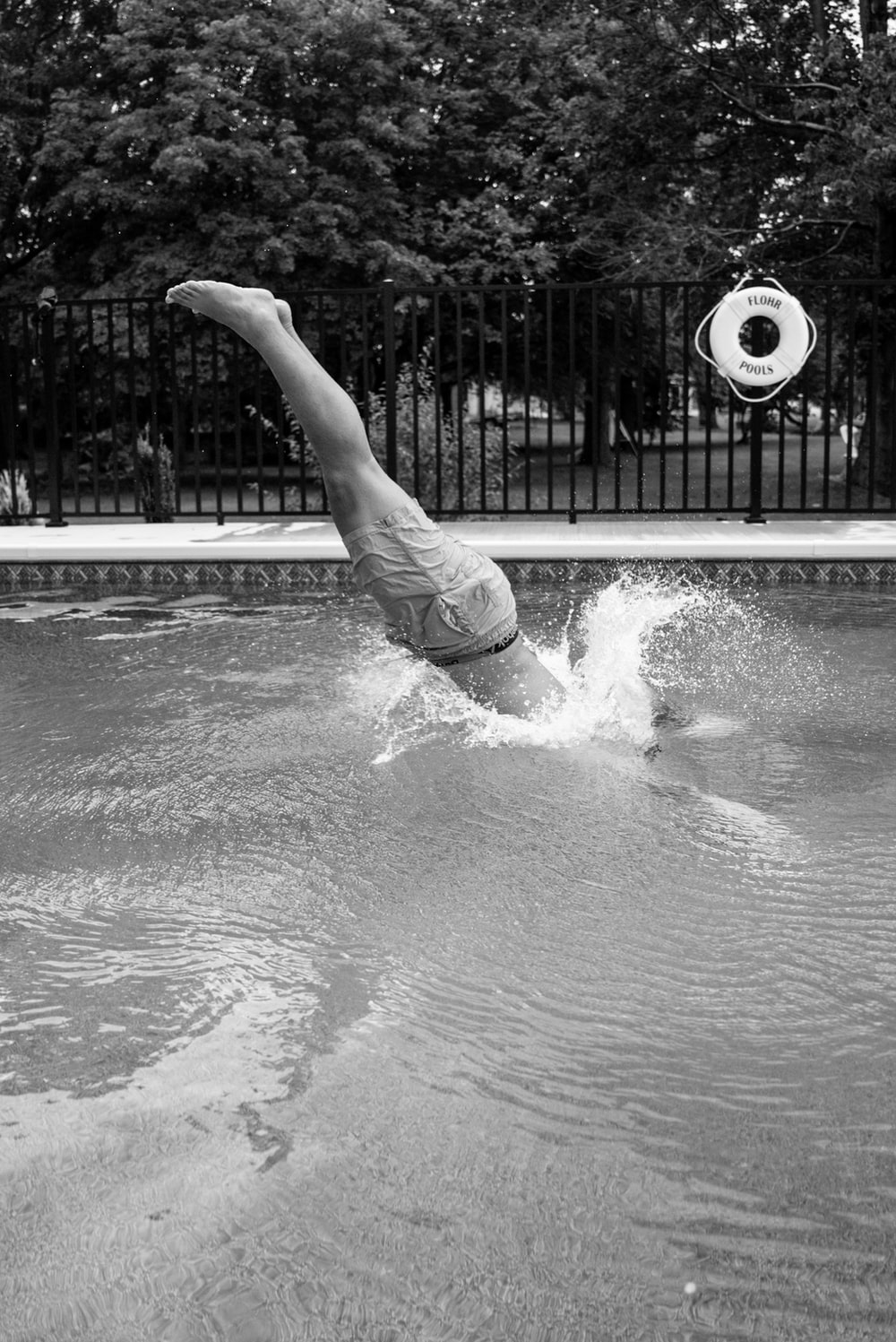 grayscale photo of woman in water