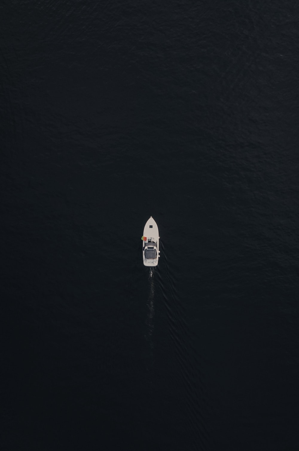 white and blue boat on sea during daytime