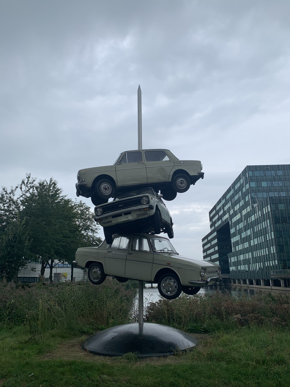 grey and black car statue near high rise building during daytime