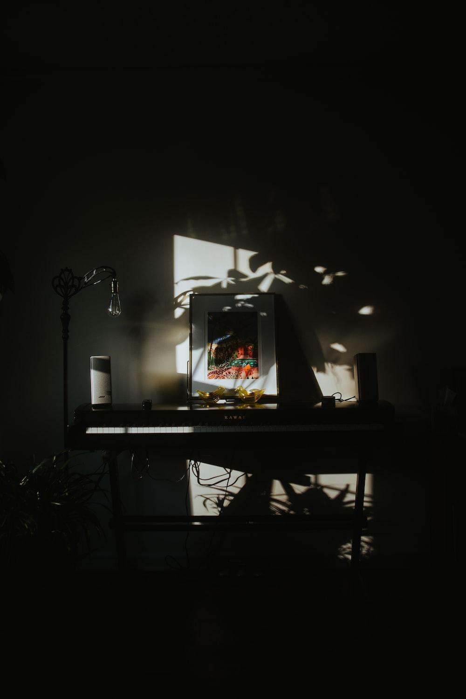black flat screen tv turned on on black wooden table