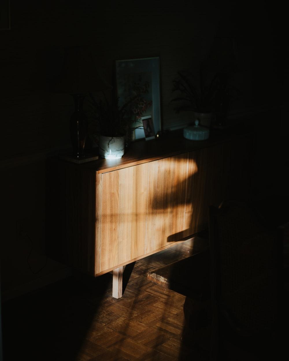 brown wooden table near black flat screen tv