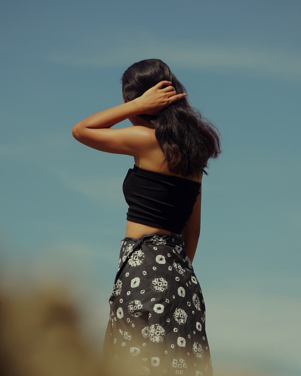 woman in black and white floral skirt