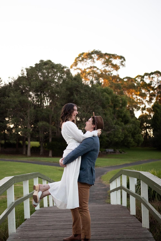 man in white dress shirt kissing woman in white dress during daytime