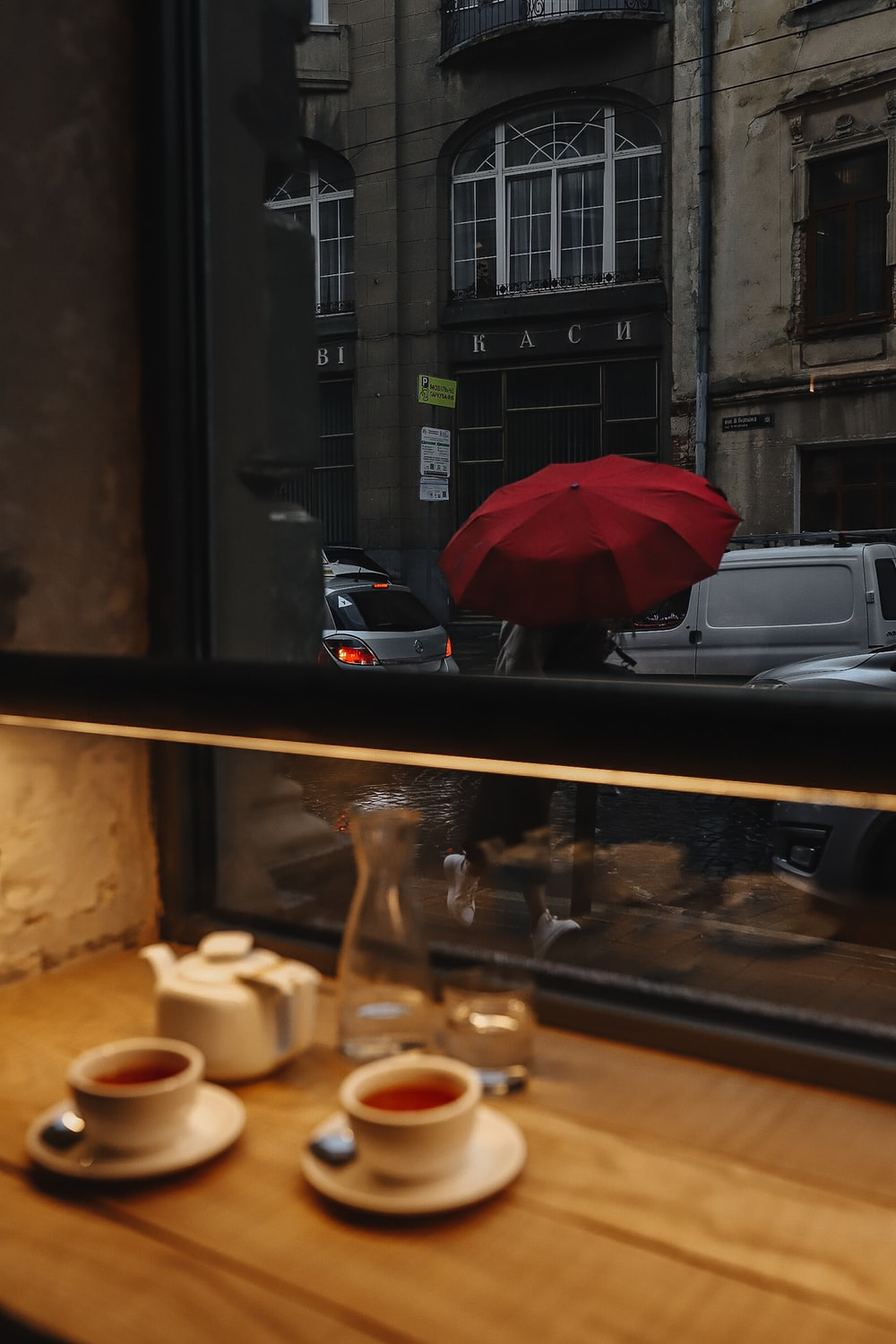 red umbrella on brown wooden table
