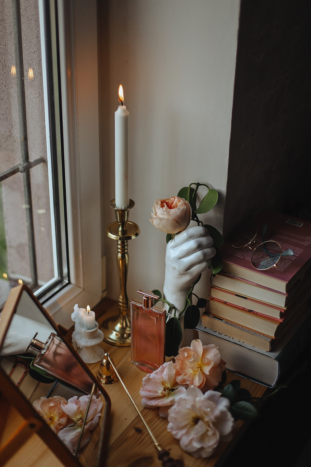 white candle on gold candle holder