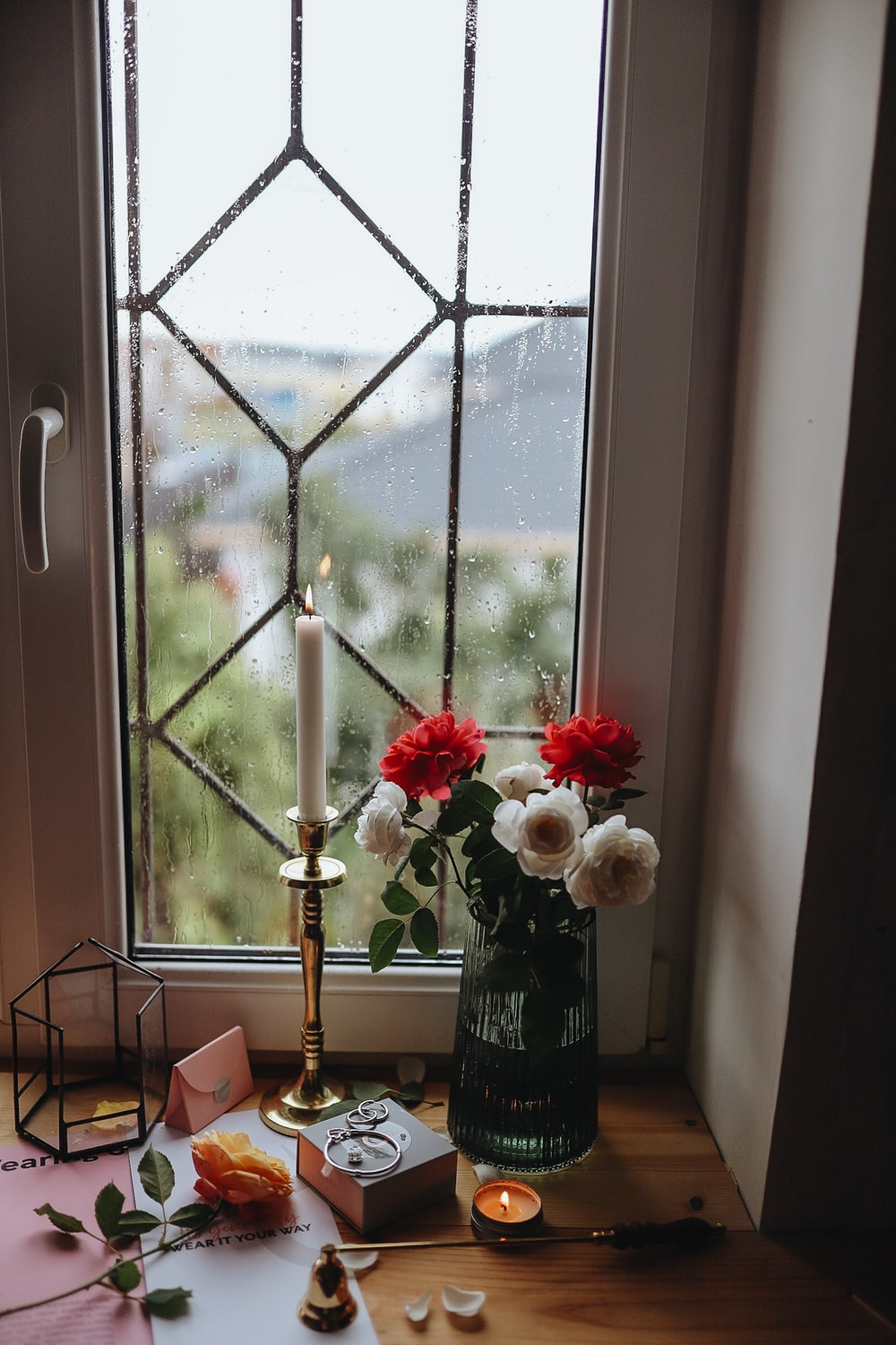 red and white roses in vase on table
