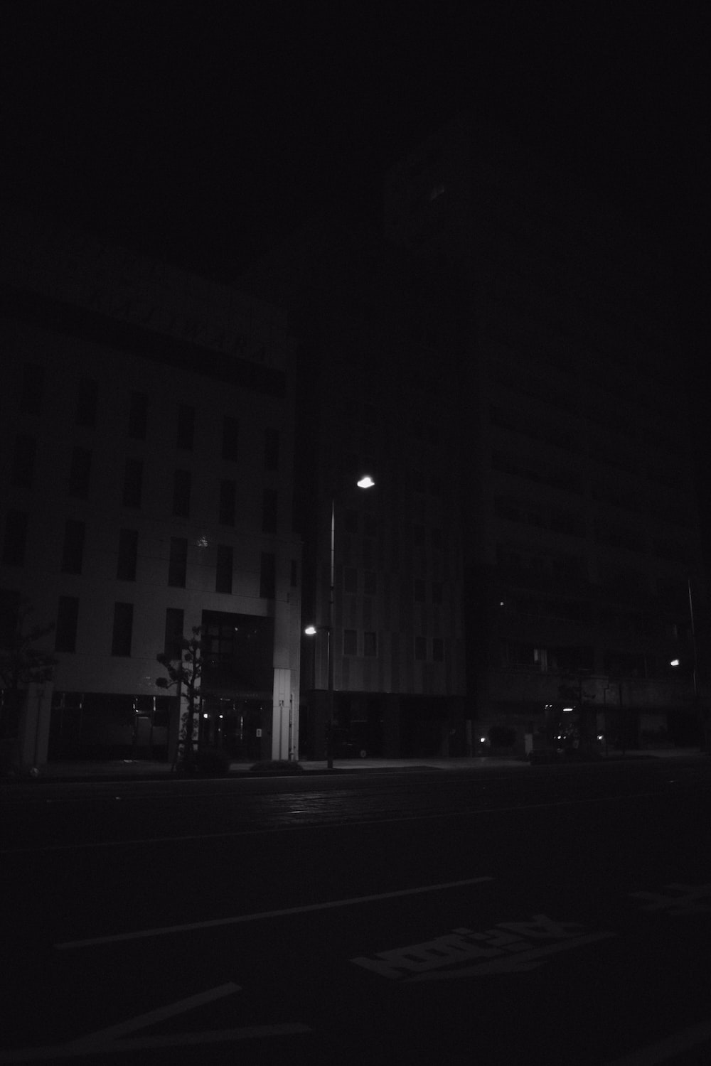 grayscale photo of city building during night time