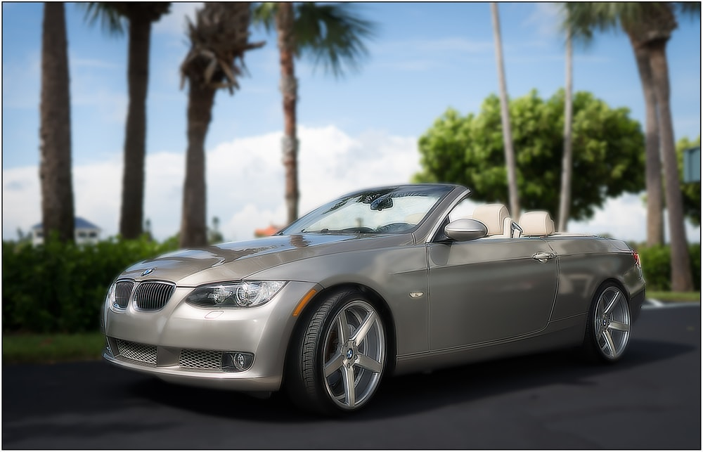 grey mercedes benz convertible coupe on road during daytime