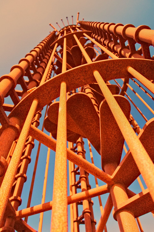 yellow metal spiral ladder during daytime