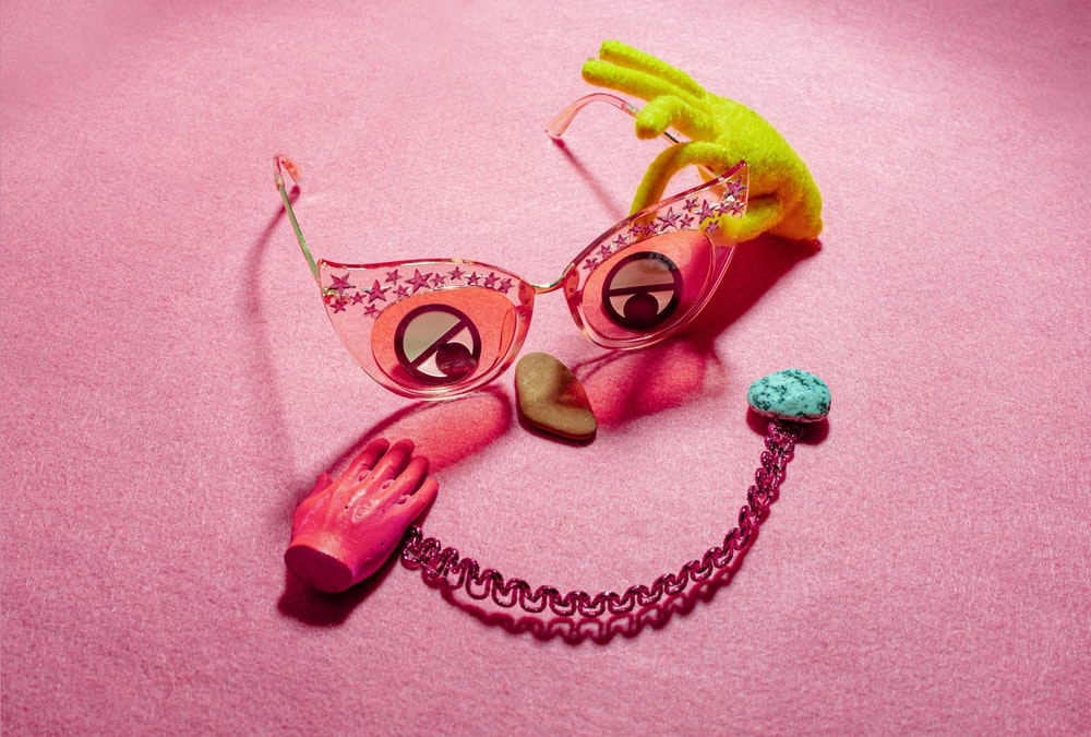 yellow green and pink heart shaped sunglasses