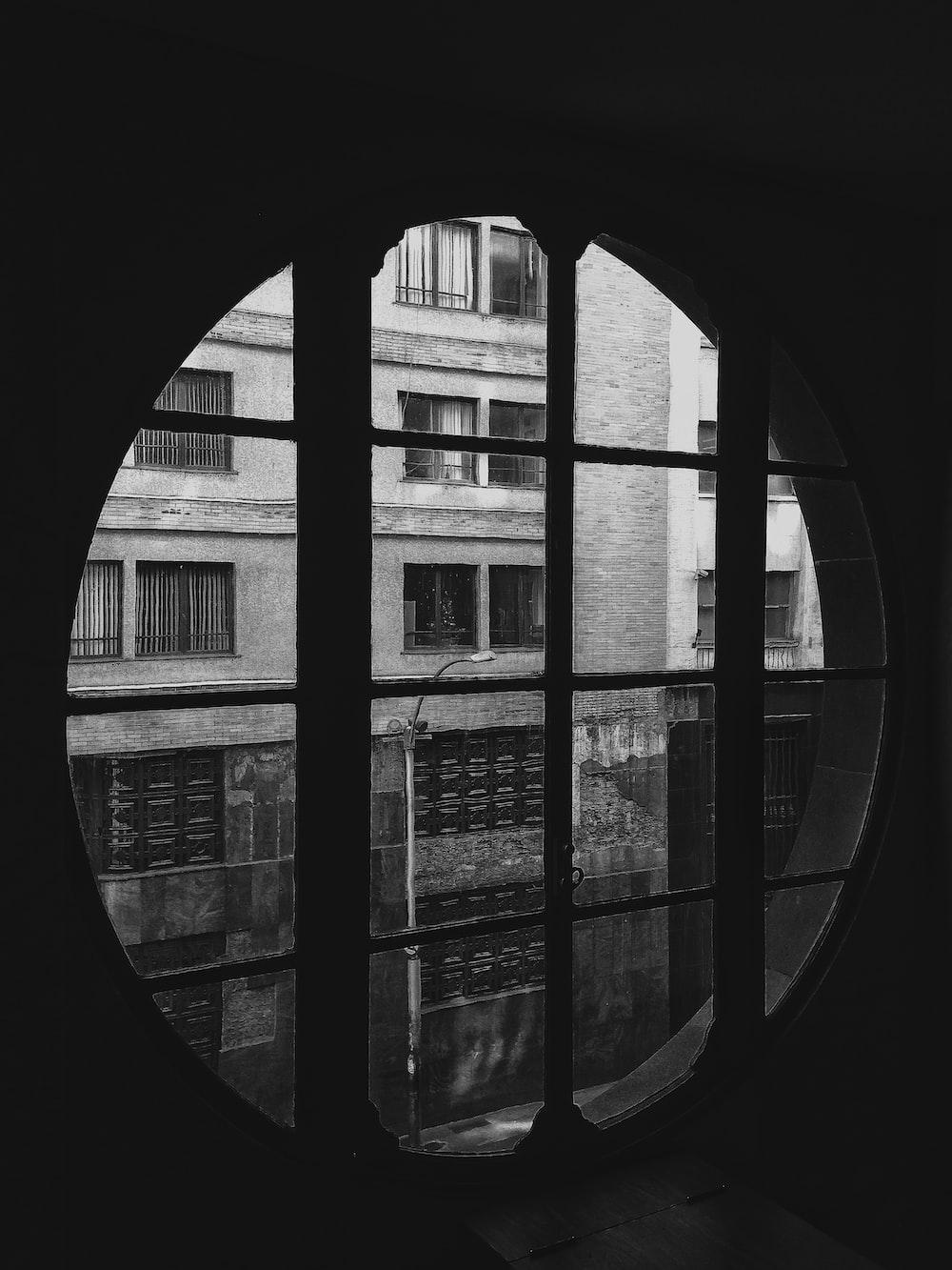 grayscale photo of glass window