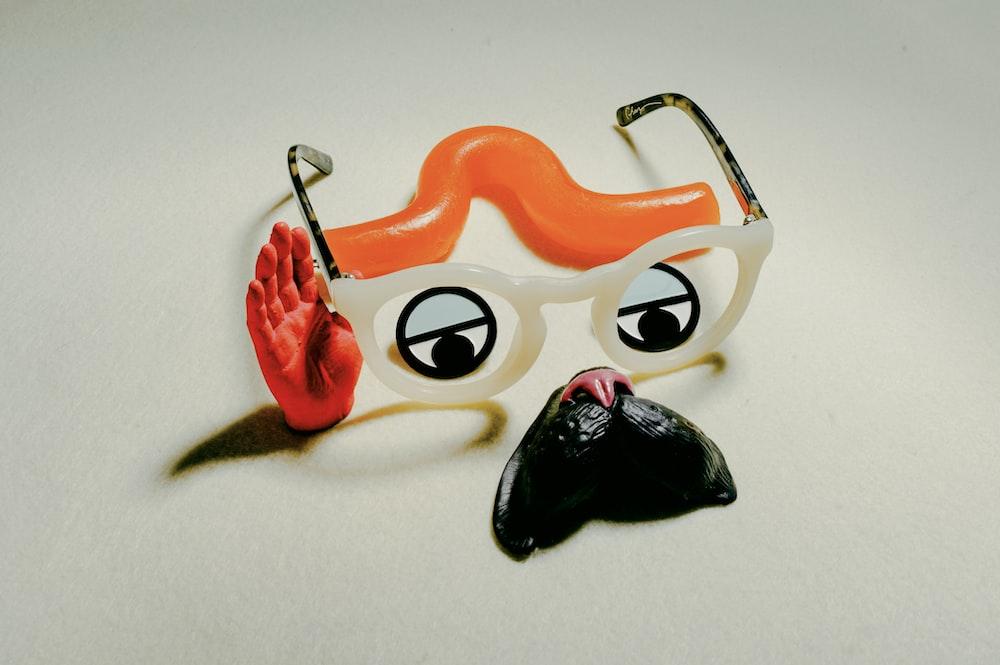 orange and black cat plastic toy