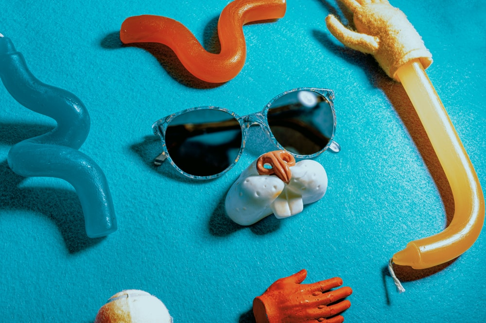 black sunglasses on teal textile
