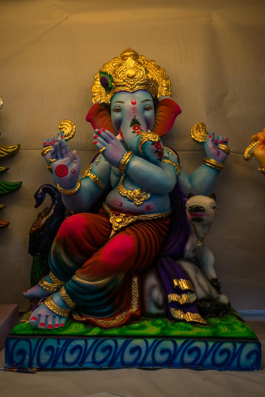 hindu deity figurine on brown wooden table