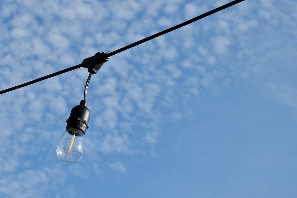black light bulb under blue sky during daytime