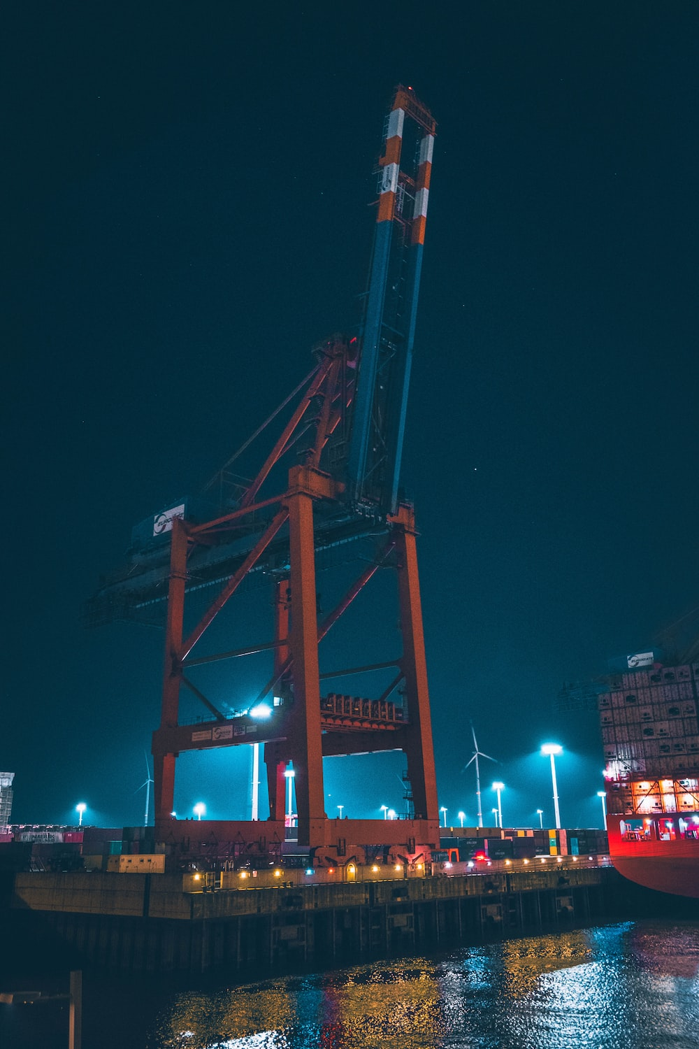 orange and blue tower crane during night time