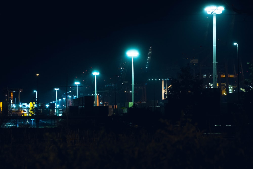 city with lights turned on during night time