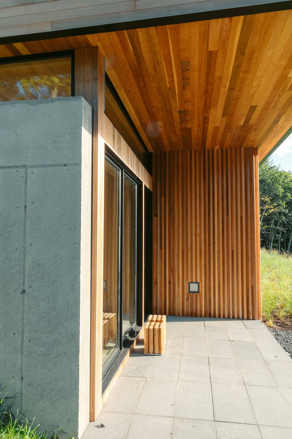 brown wooden bench near brown wooden door