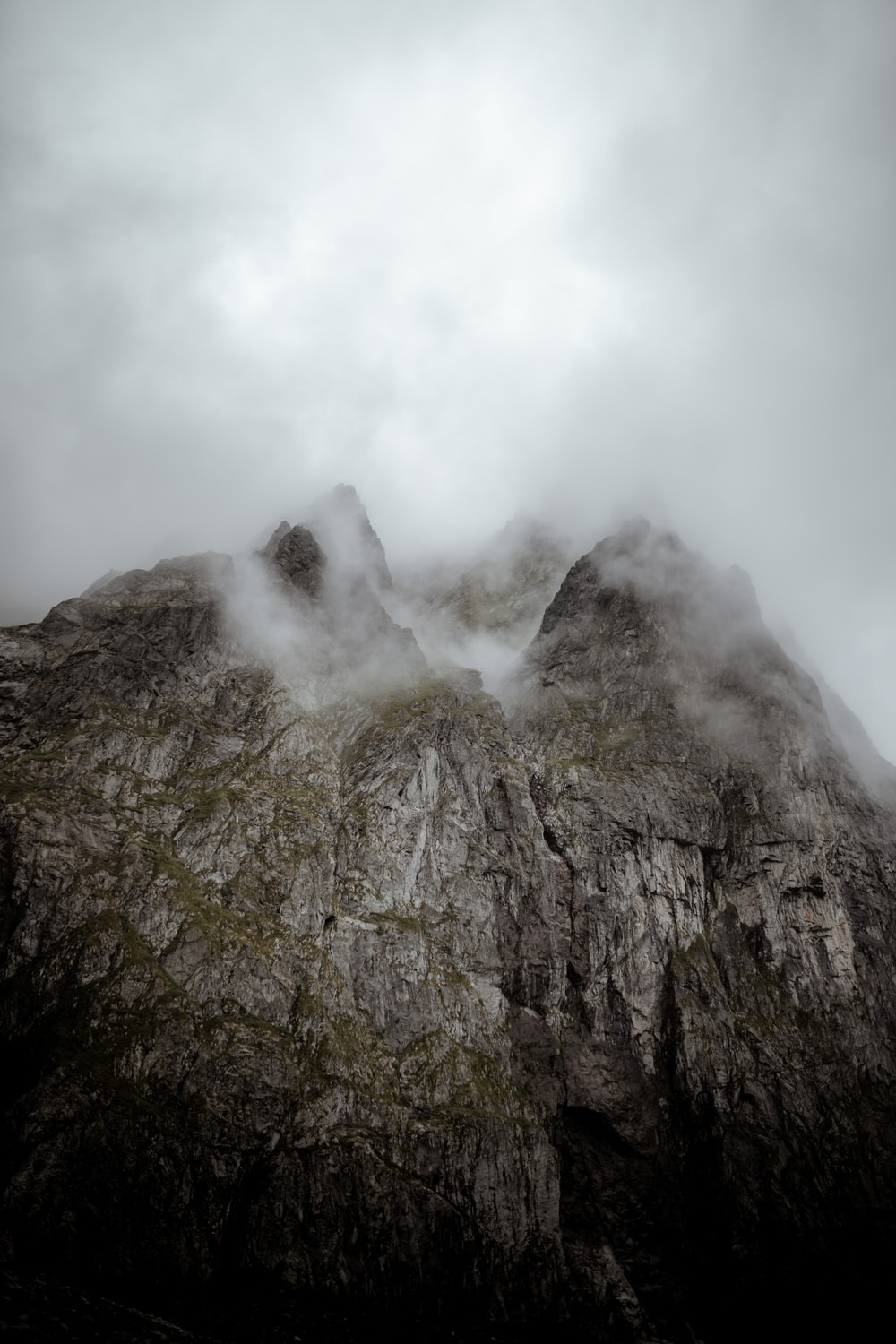 gray and green mountain under white clouds