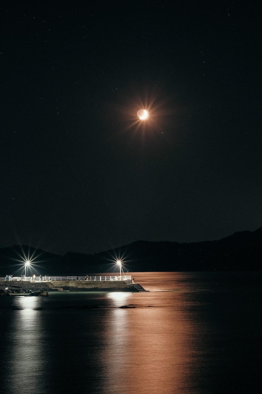 white ship on sea during night time