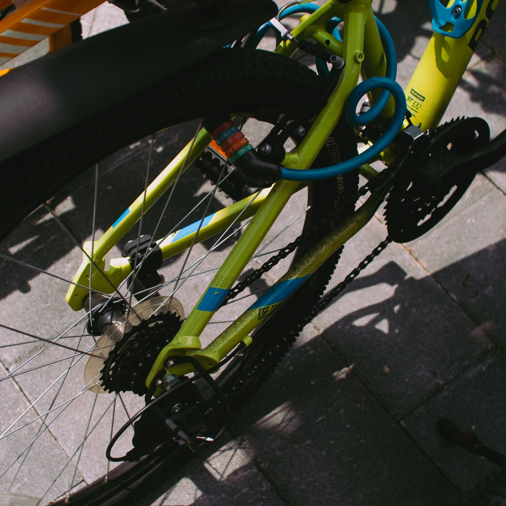 green and black bicycle on gray concrete floor