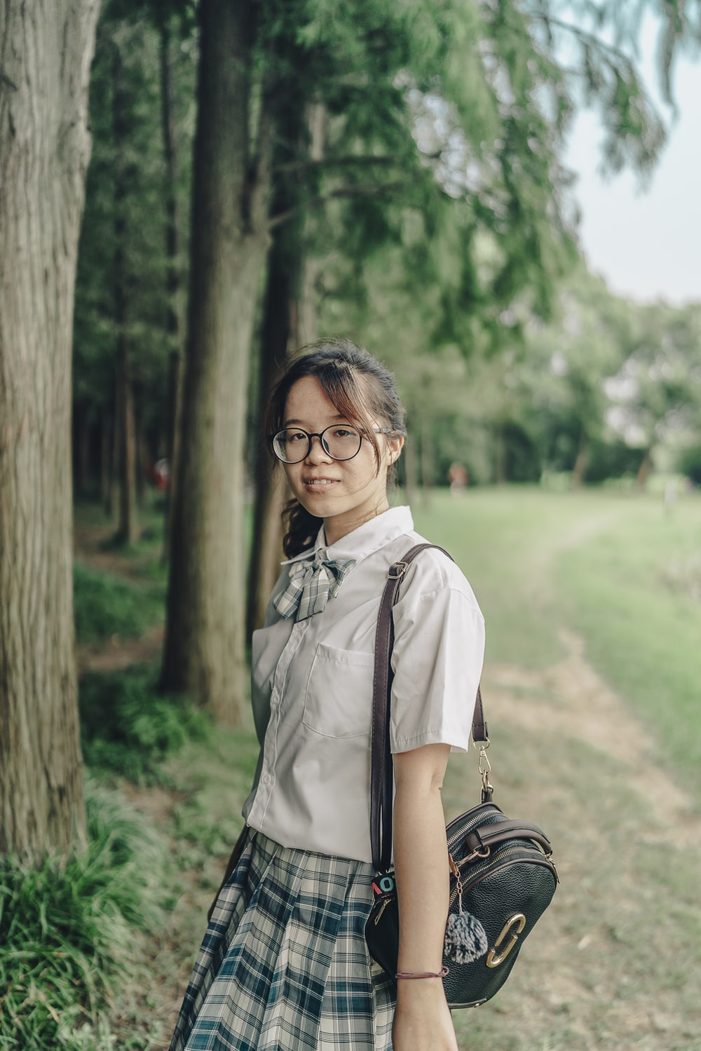 woman in white button up shirt wearing black framed eyeglasses