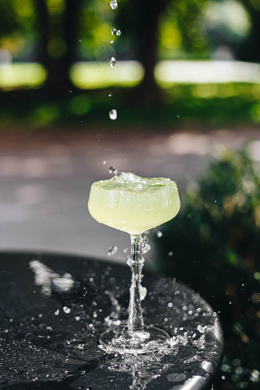 water splash on green leaf