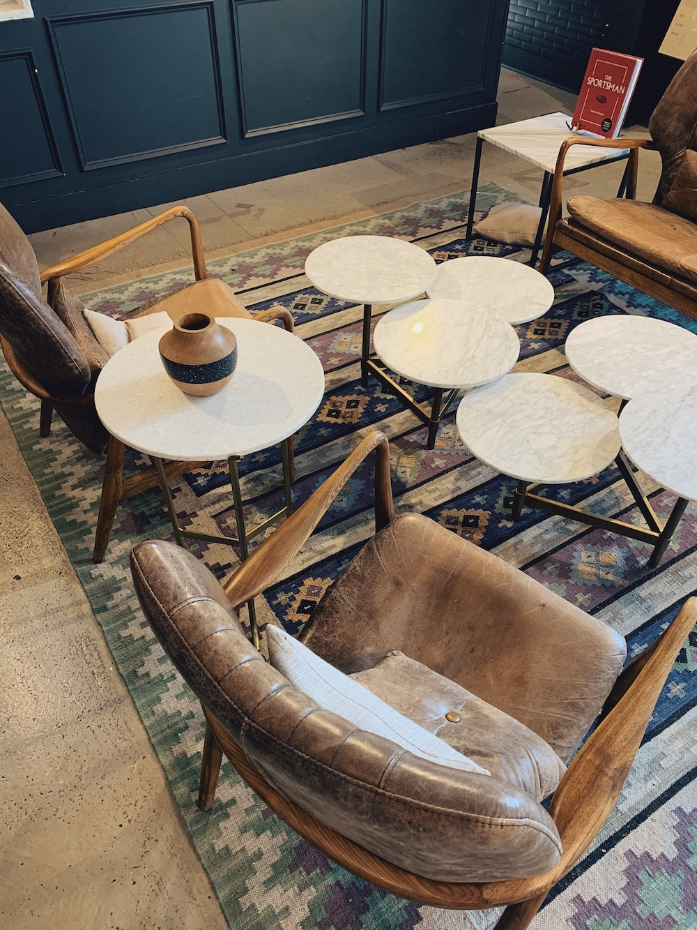 brown wooden round table with chairs