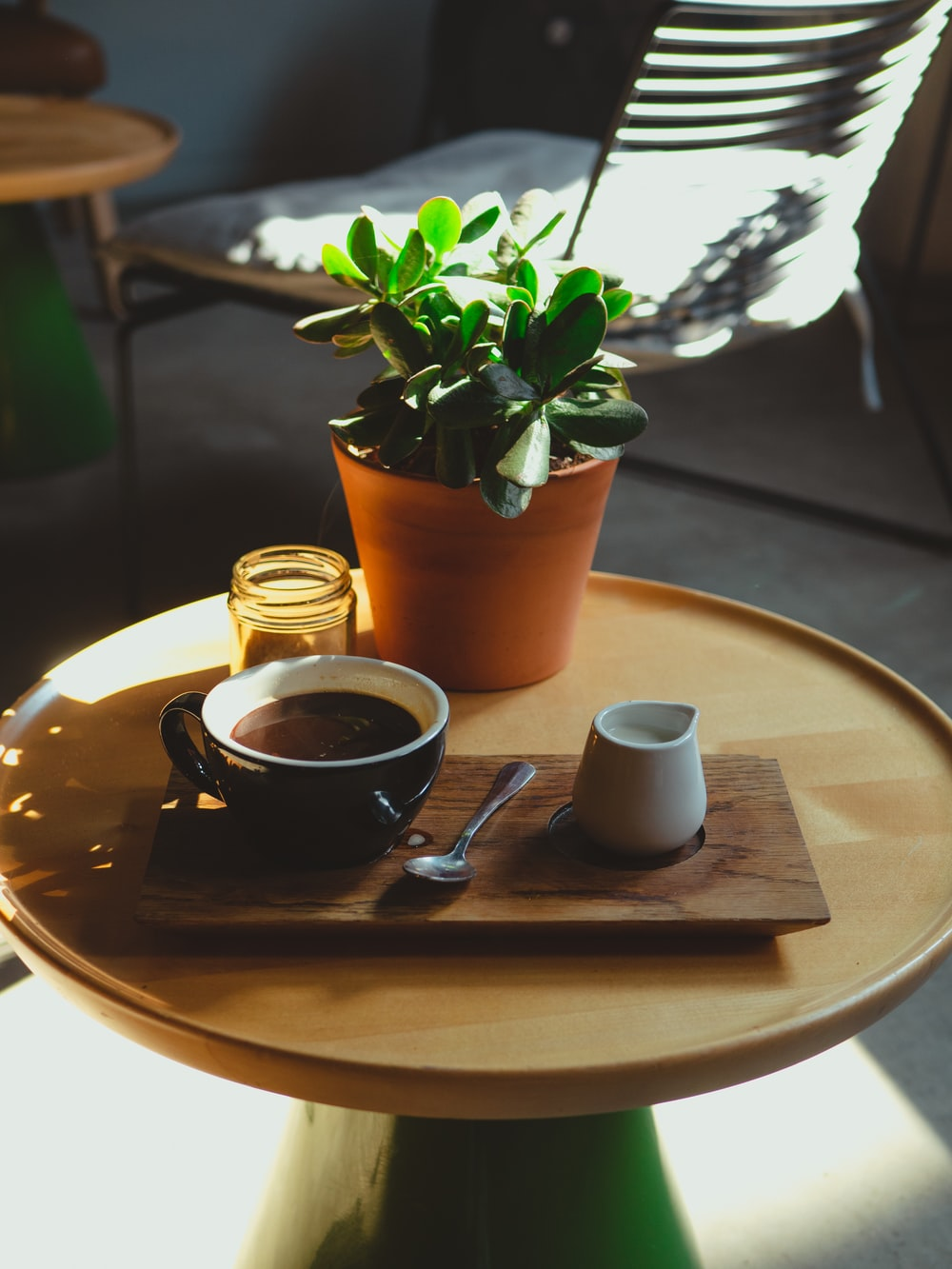 brown ceramic cup on brown wooden table