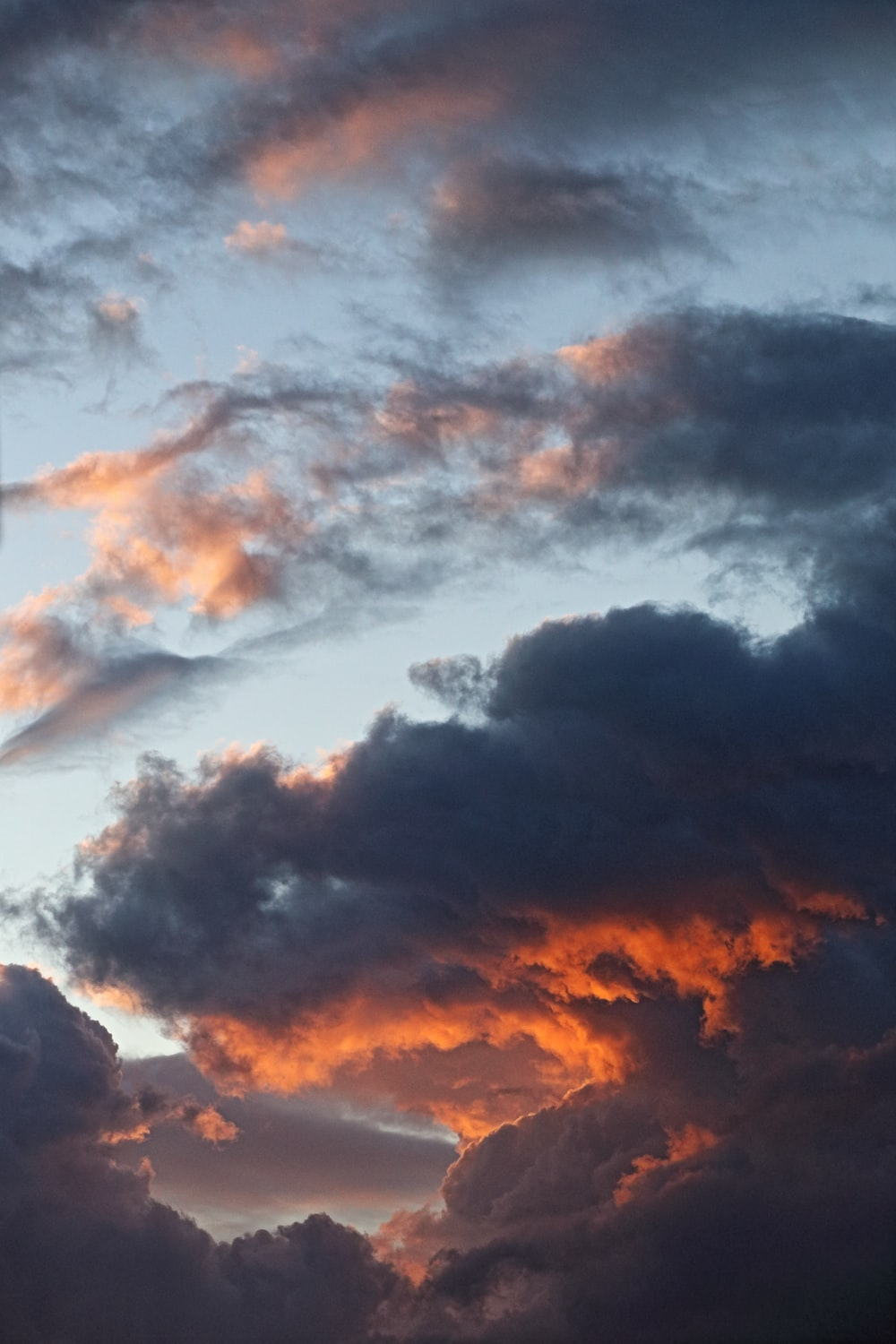 black and white clouds during sunset