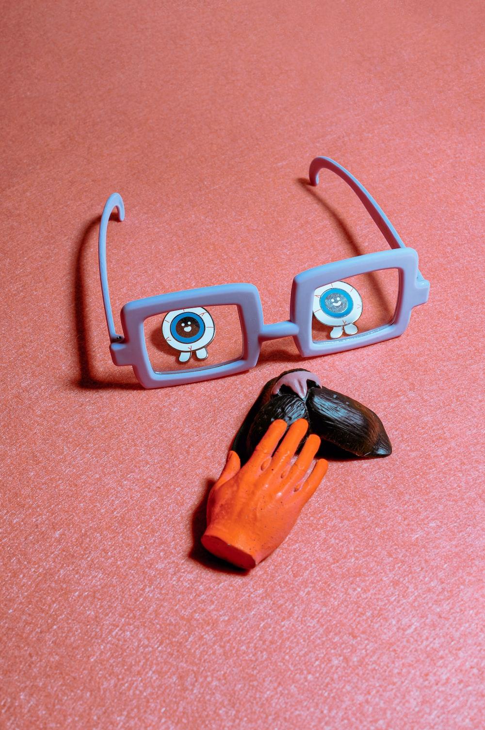 orange and black plastic hair clip
