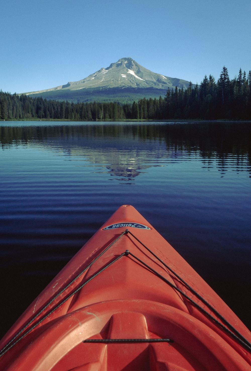 orange kayak on lake during daytime