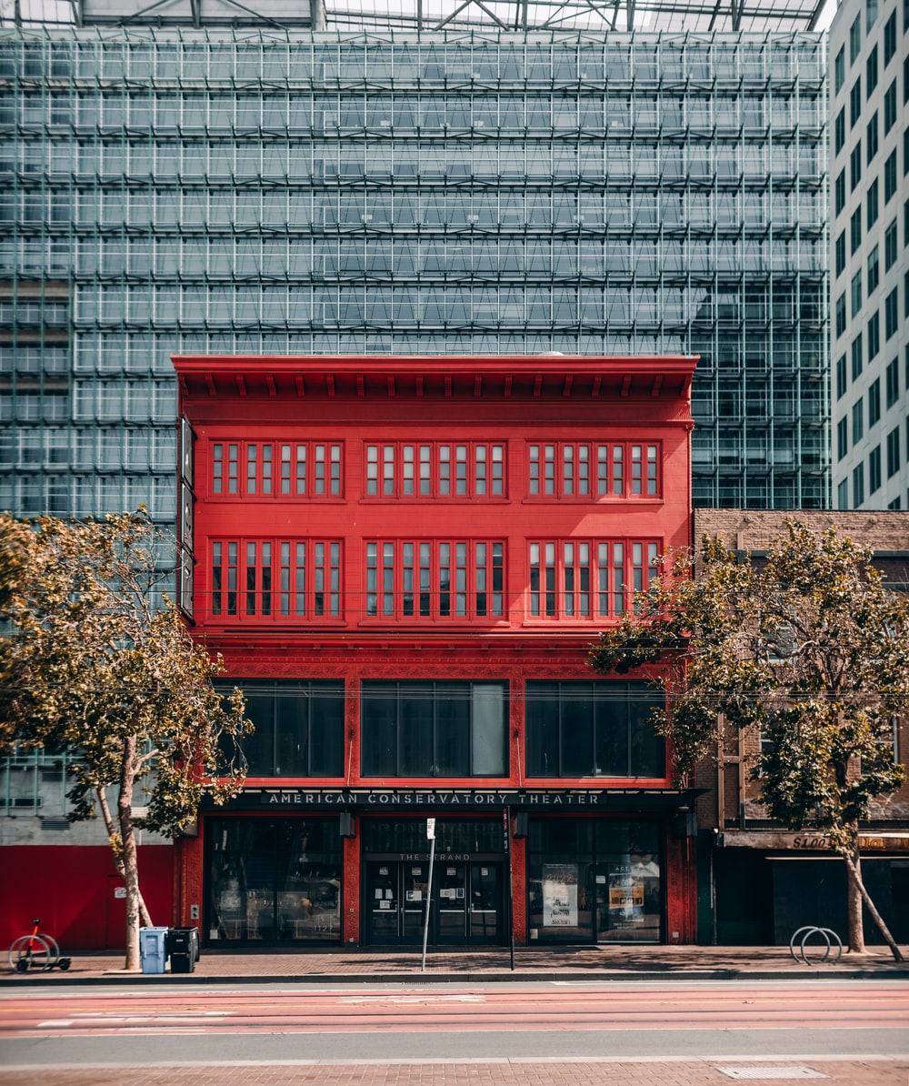 red wooden framed glass window building