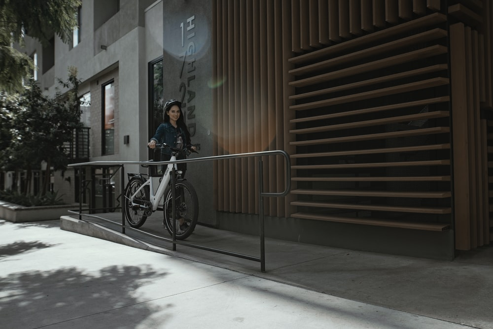 woman in black jacket riding bicycle