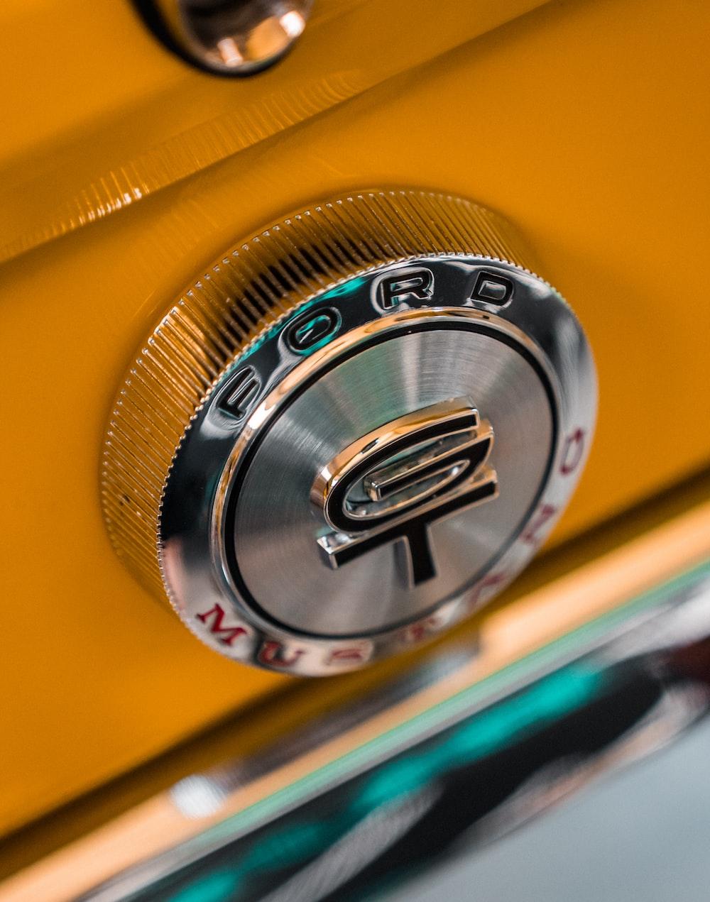 yellow and silver mercedes benz emblem